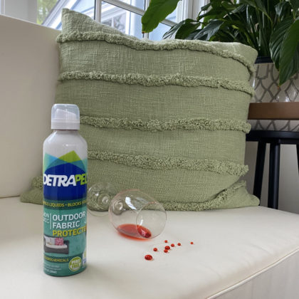 Outdoor Fabric protector on white couch repels liquids