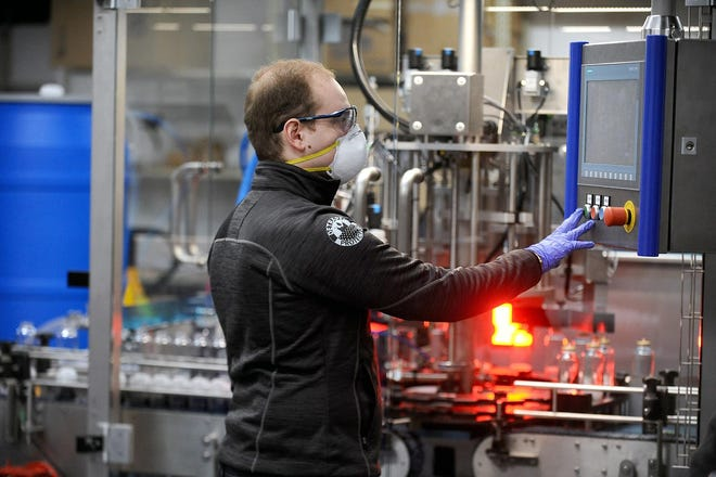David Zamarin founder and CEO of DetraPel Inc, works inside the company's Blandin Avenue production facility in April 2020