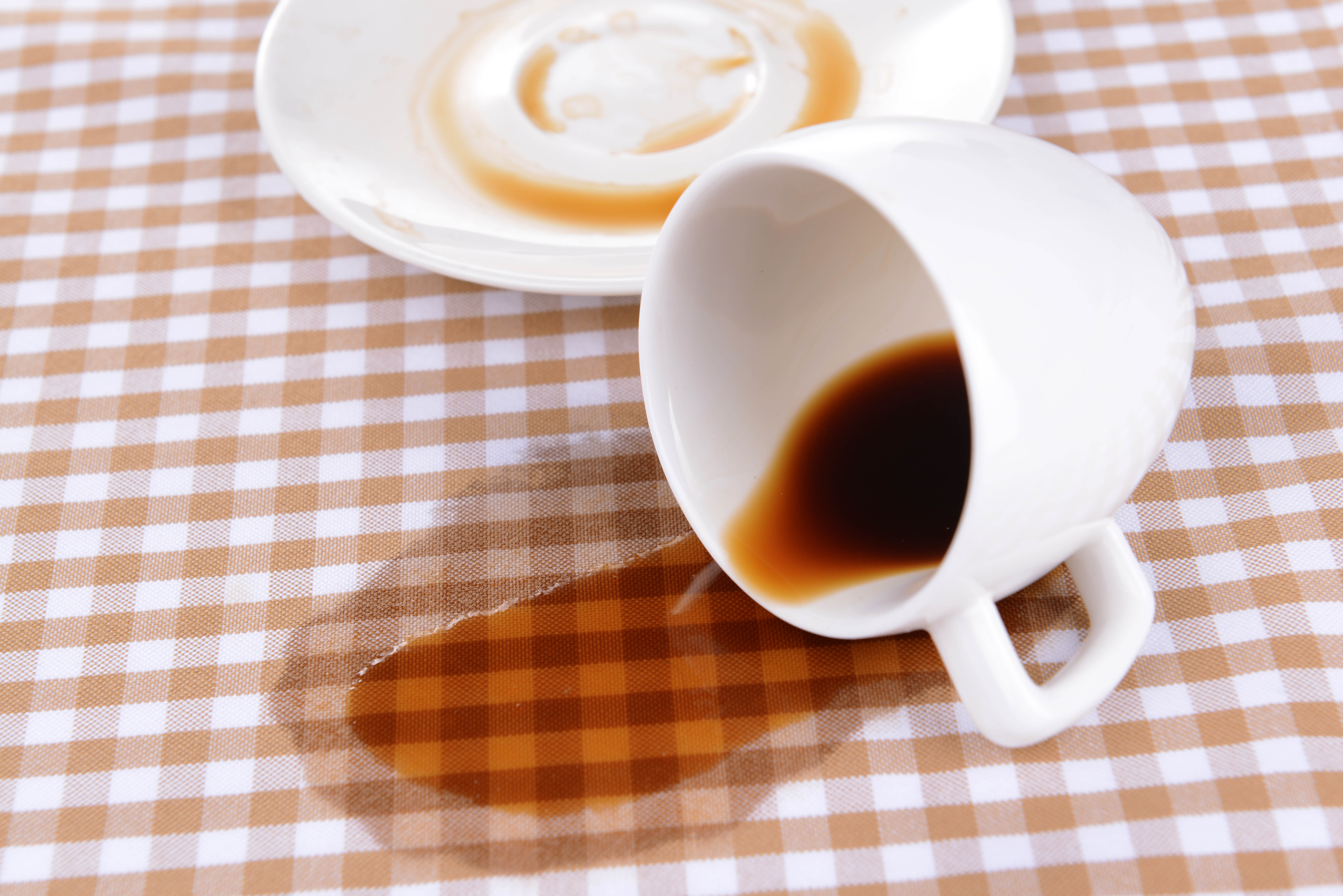 coffee spilled on tablecloth